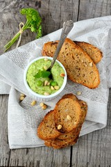 Green pea hummus with pine nuts and thin croutons