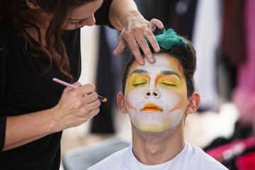 Sylist Putting Makeup on Clown