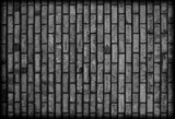 Background of dark black brickwall texture.