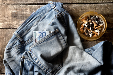 Pair of dirty jeans,twenty euro bill and an ashtray
