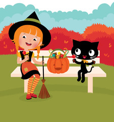 Girl witch with her cat celebrate Halloween