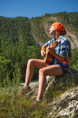tourist girl playing a guitar