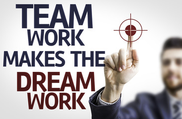 Business man pointing: Team Work Makes the Dream Work