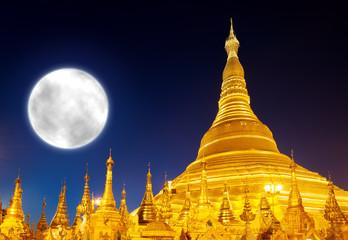 Shwedagon Pagoda and big moon in Yangon, Myanmar (Burma)