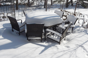 Patio covered with snow on a bright winter day