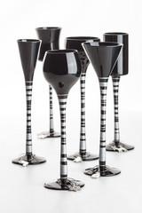 Six black coloured champagne glasses