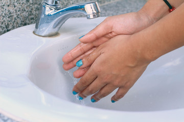Woman Washing Hands or Cleaning Hands.