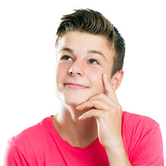 Handsome teen looking at corner isolated.