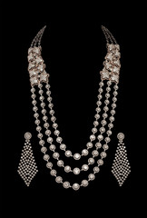 Close up of diamond necklace with earrings
