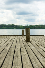 Old wooden pier with docking poles
