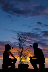 silhouette man and woman eating each others marshmallows