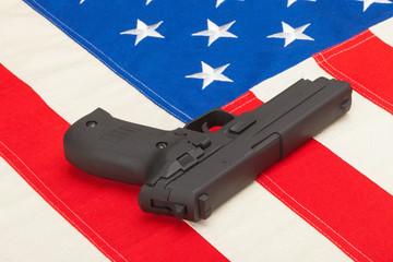 Handgun laying over USA flag - studio shoot