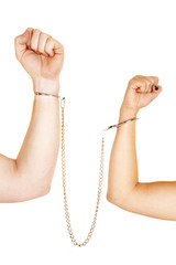man and woman arms handcuffs fists up