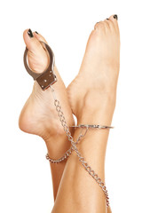 woman feet with handcuffs