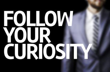 Follow your Curiosity written on a board
