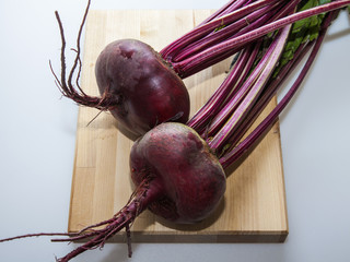 Two large fresh beets on a table