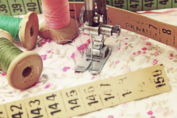 sewing machine, dressmaker scissors and thread-style retro