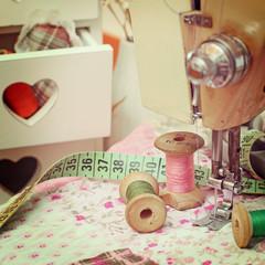 sewing machine, dressmaker scissors and thread-style retro