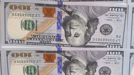 new bills of 100 dollars rotating