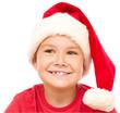 Portrait of a cute little girl in santa hat
