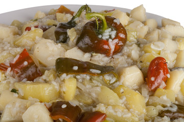 vegetable stew with sweet peppers and rice on a plate, isolated