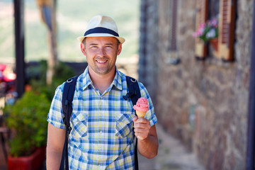 Happy young man holding ice cream