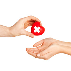 hand giving heart with red cross symbol