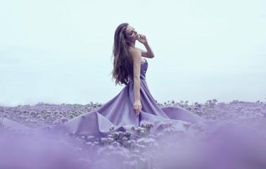 Sensual woman in blue dress