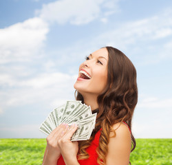woman in red dress with us dollar money