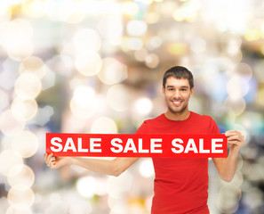 man in red t-shirt with sale sign