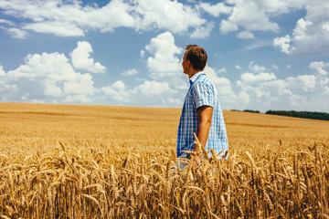 Man standing on wheat field