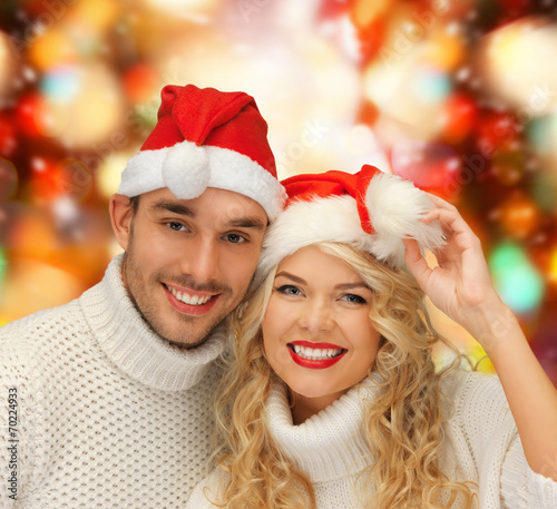 canvas print picture smiling couple in sweaters and santa helper hats