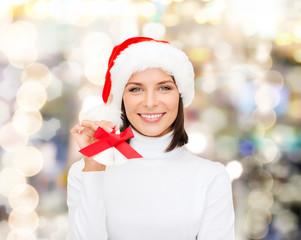 smiling woman in santa helper hat and jingle bells