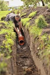 excavator digging drains, self-help