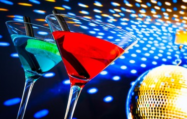 blue and red cocktail with gold sparkling disco ball background
