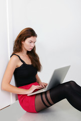 Pretty girl on laptop with busy expression