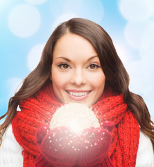 smiling woman in winter clothes with snowball