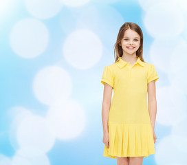 smiling little girl in yellow dress
