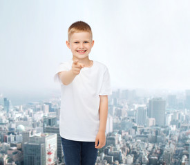 smiling little boy in white blank t-shirt