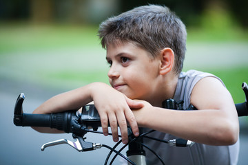 Portrait of little boy on a bicycle outdoors
