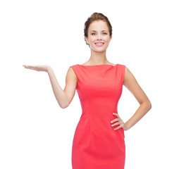 smiling woman holding something imaginary on palm