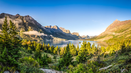 Panoramic landscape view of Glacier NP mountain range and lake