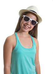 Teanager girl in a hat and sunglasses