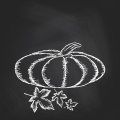 Hand drawn invitation with pumpkins on chalkboard background