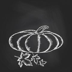Hand drawn invitation with pumpkins on chalkboard background