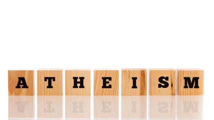 Row of wooden blocks spelling - Atheism