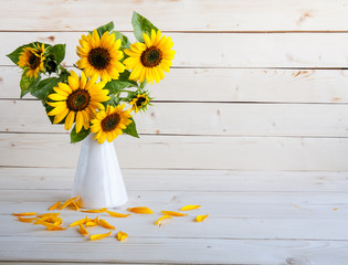 A bouquet of autumn sunflowers in a vase