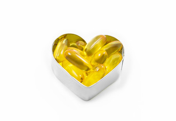 Fish Oil in hear shape box isolated