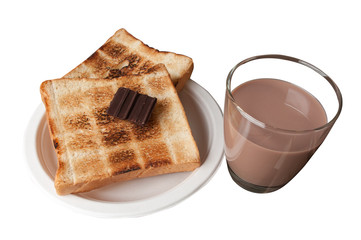 Glass of chocolate milk on the table and toast.