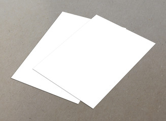 White blank flyer on textured background